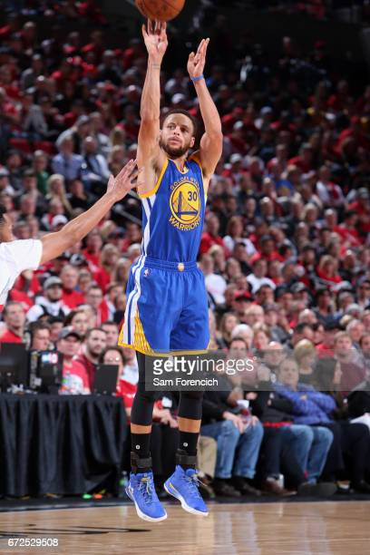 Stephen Curry of the Golden State Warriors shoots the ball against the Portland Trail Blazers during Game Four of the Western Conference...