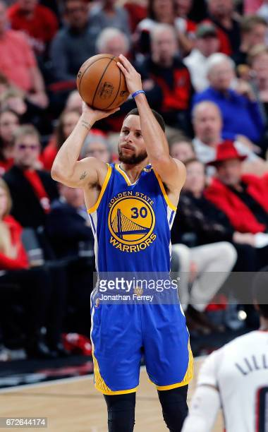 Stephen Curry of the Golden State Warriors shoots the ball agianst the Portland Trail Blazers during Game Three of the Western Conference...