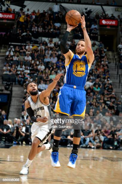 Stephen Curry of the Golden State Warriors shoots the ball against the San Antonio Spurs during Game Four of the Western Conference Finals of the...