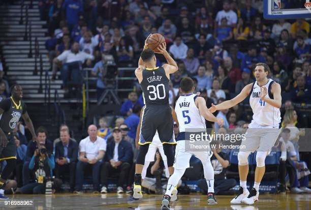 Stephen Curry of the Golden State Warriors shoots the ball against the Dallas Mavericks during an NBA basketball game at ORACLE Arena on February 8...