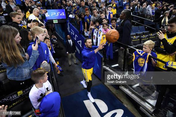 Stephen Curry of the Golden State Warriors shoots the ball before the game against the Indiana Pacers on March 21 2019 at ORACLE Arena in Oakland...