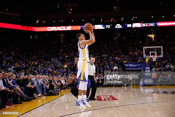 Stephen Curry of the Golden State Warriors shoots the ball during their game against the Detroit Pistons at ORACLE Arena on November 9 2015 in...