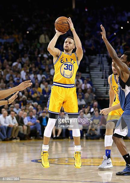 Stephen Curry of the Golden State Warriors shoots the ball during their game against the Minnesota Timberwolves at ORACLE Arena on April 5 2016 in...