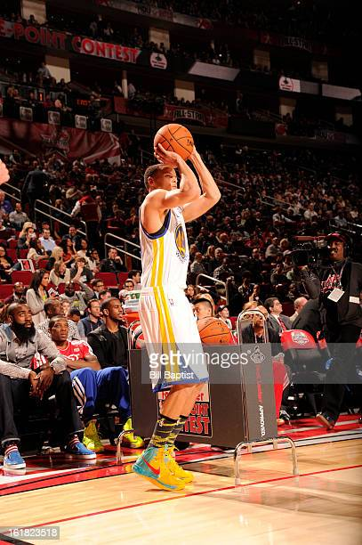 Stephen Curry of the Golden State Warriors shoots the ball during the 2013 Foot Locker ThreePoint Contest on State Farm AllStar Saturday Night as...