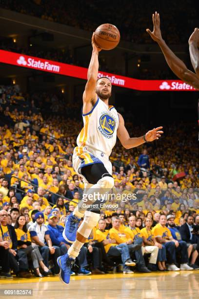 Stephen Curry of the Golden State Warriors shoots the ball during the game against the Portland Trail Blazers during the Western Conference...
