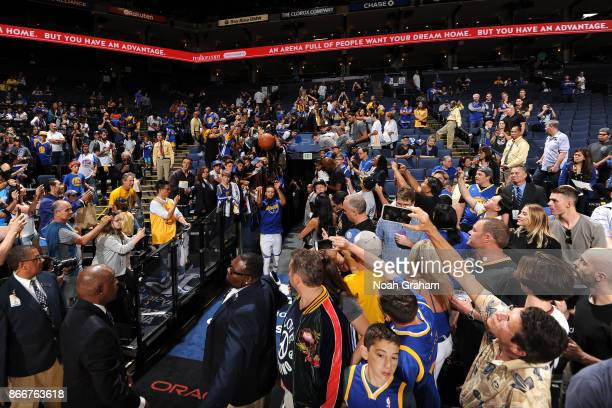 Stephen Curry of the Golden State Warriors shoots the ball from the tunnel before the game against the Toronto Raptors on October 25 2017 at ORACLE...