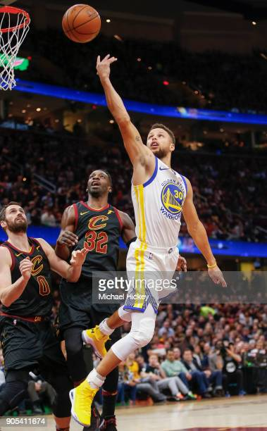 Stephen Curry of the Golden State Warriors shoots the ball over Jeff Green of the Cleveland Cavaliers at Quicken Loans Arena on January 15 2018 in...