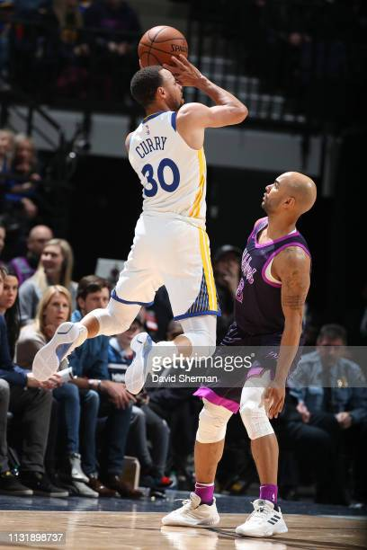 Stephen Curry of the Golden State Warriors shoots the ball over Jerryd Bayless of the Minnesota Timberwolves on March 19 2019 at Target Center in...