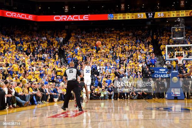 Stephen Curry of the Golden State Warriors shoots the ball to end the first half against the Cleveland Cavaliers in Game One of the 2018 NBA Finals...