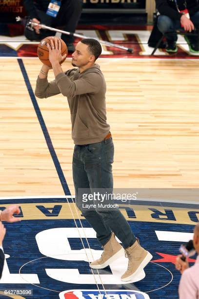 Stephen Curry of the Golden State Warriors shoots the ball to raise money for Sager Strong during the JBL ThreePoint Contest during State Farm...