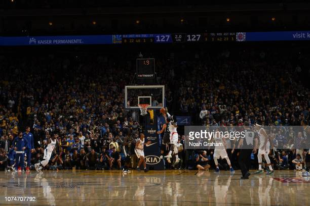 Stephen Curry of the Golden State Warriors shoots the gamewinner against Montrezl Harrell of the LA Clippers on December 23 2018 at ORACLE Arena in...
