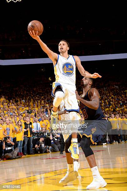 Stephen Curry of the Golden State Warriors shoots to tie the game at 87 points during the fourth quarter of Game Two of the 2015 NBA Finals on June 7...