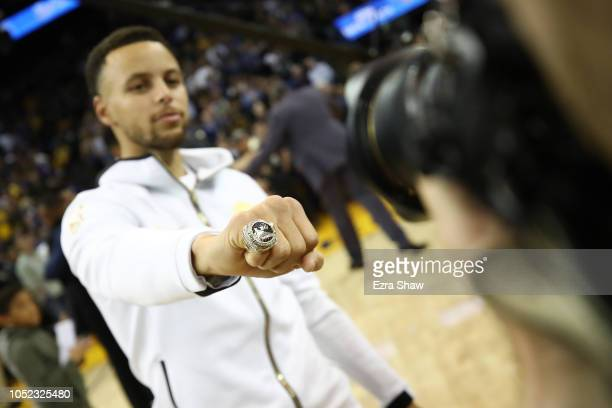 Stephen Curry of the Golden State Warriors shows his 20172018 Championship ring prior to their game against the Oklahoma City Thunder at ORACLE Arena...