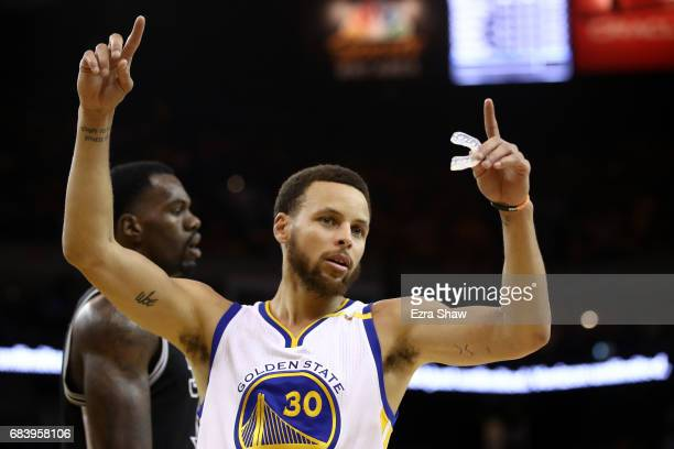 Stephen Curry of the Golden State Warriors signals after a play against the San Antonio Spurs during Game Two of the NBA Western Conference Finals at...