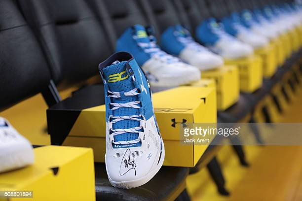 Stephen Curry of the Golden State Warriors signed Under Armour sneakers for fans before the game against the Oklahoma City Thunder on February 6 2016...