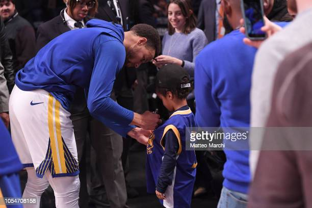 Stephen Curry of the Golden State Warriors signs autographs before the game against the Brooklyn Nets at Barclays Center on October 28 2018 in the...