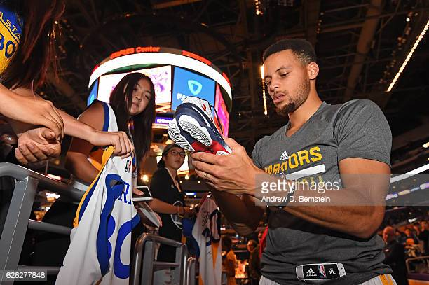 Stephen Curry of the Golden State Warriors signs autographs before the game at the Staples Center against the Los Angeles Lakers on November 25 2016...