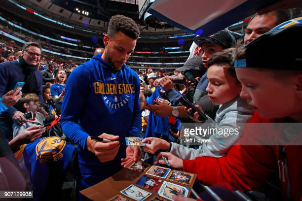 Stephen Curry of the Golden State Warriors signs autographs for fans before the game against the Chicago Bulls on January 17 2018 at the United...