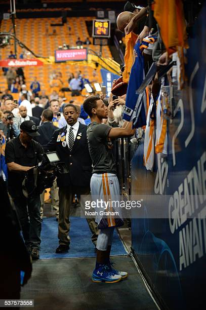 Stephen Curry of the Golden State Warriors signs autographs in the tunnel before Game Five of the Western Conference Finals against the Oklahoma City...