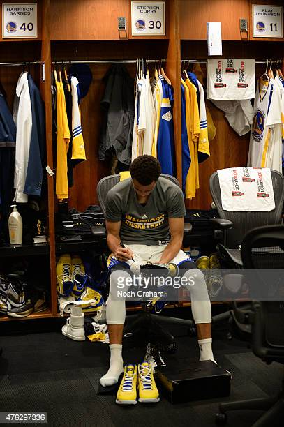 Stephen Curry of the Golden State Warriors sits in the locker room before the game against the Cleveland Cavaliers in Game Two of the 2015 NBA Finals...