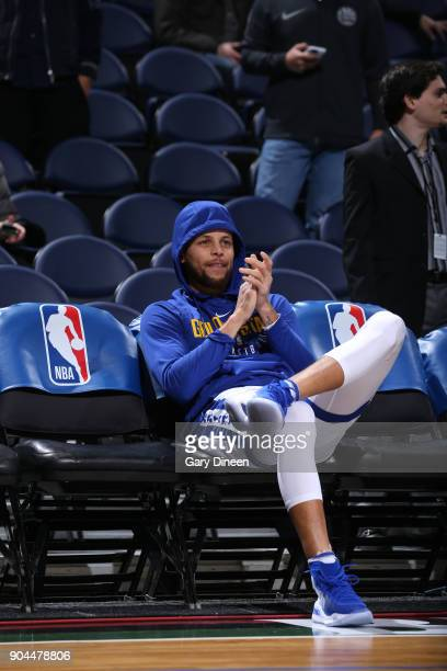 Stephen Curry of the Golden State Warriors sits on the bench before the game against the Milwaukee Bucks on January 12 2018 at the BMO Harris Bradley...