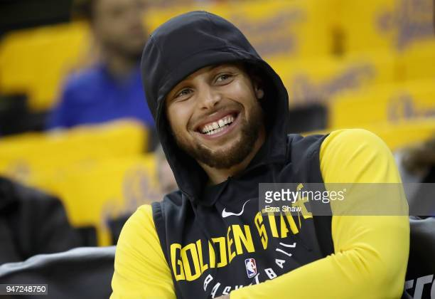 Stephen Curry of the Golden State Warriors sits on the bench before their game against the San Antonio Spurs in Game 2 of Round 1 of the 2018 NBA...