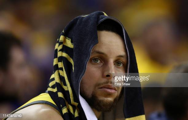 Stephen Curry of the Golden State Warriors sits on the bench during their game against the LA Clippers during Game Two of the first round of the 2019...