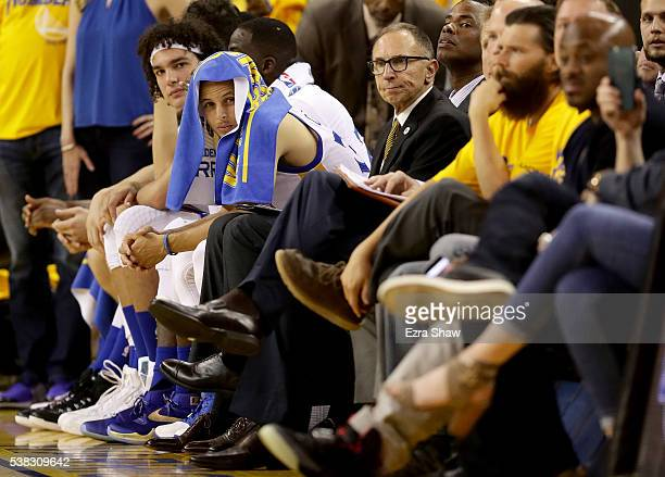 Stephen Curry of the Golden State Warriors sits on the bench during Game 2 of the 2016 NBA Finals against the Cleveland Cavaliers at ORACLE Arena on...