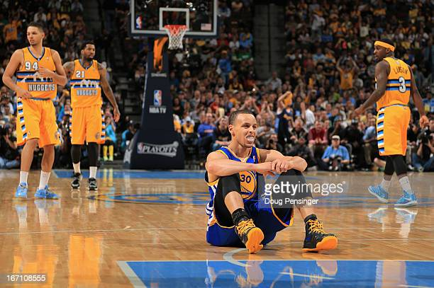 Stephen Curry of the Golden State Warriors sits on the court following a play against the Denver Nuggets during Game One of the Western Conference...
