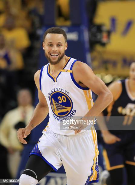 Stephen Curry of the Golden State Warriors smiles after making a basket against the Utah Jazz during Game Two of the Western Conference Semifinals of...