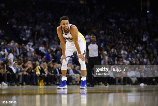 Stephen Curry of the Golden State Warriors smiles before shooting a free throw for a techinal foul called on the New York Knicks at ORACLE Arena on...