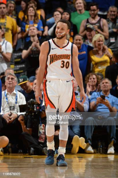 Stephen Curry of the Golden State Warriors smiles during the game against the LA Clippers on April 7 2019 at ORACLE Arena in Oakland California NOTE...
