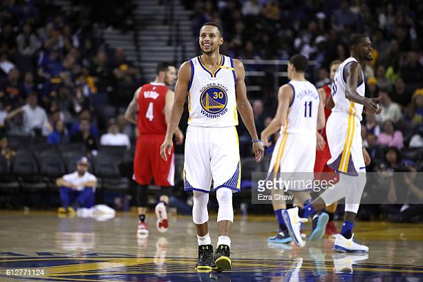 Stephen Curry of the Golden State Warriors smiles during their preseason game against the Los Angeles Clippers at ORACLE Arena on October 4 2016 in...