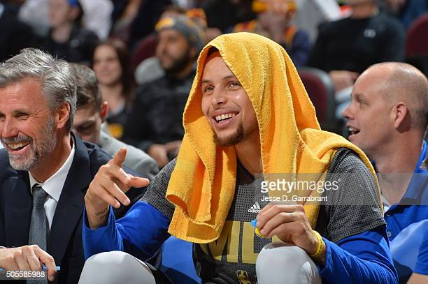 Stephen Curry of the Golden State Warriors smiles from the bench against the Cleveland Cavaliers on January 18 2016 at Quicken Loans Arena in...