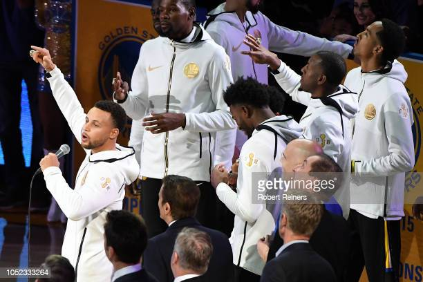 Stephen Curry of the Golden State Warriors speaks during the 20172018 Championship ring ceremony prior to their game against the Oklahoma City...