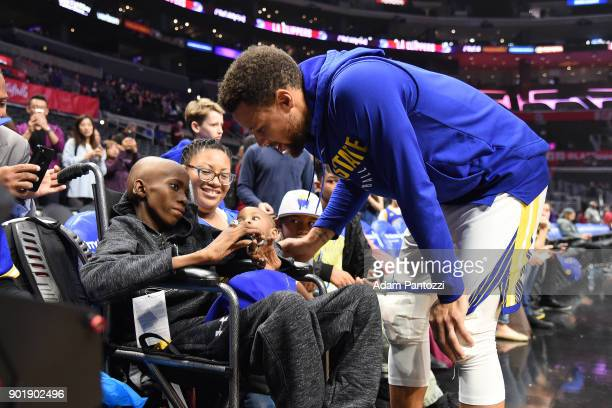 Stephen Curry of the Golden State Warriors speaks to a fan before the game against the LA Clippers on January 6 2018 at STAPLES Center in Los Angeles...