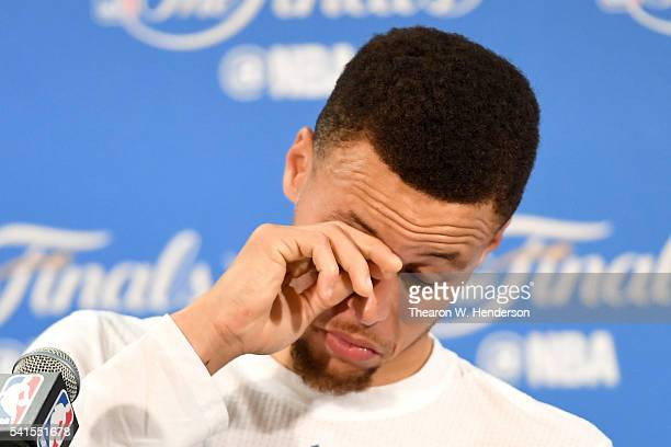 Stephen Curry of the Golden State Warriors speaks to members of the media after being defeated by the Cleveland Cavaliers in Game 7 of the 2016 NBA...