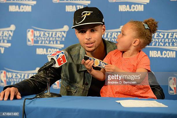 Stephen Curry of the Golden State Warriors speaks to the media with his daughter Riley Curry after Game Five of the Western Conference Finals against...