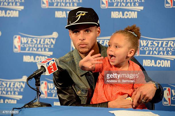 Stephen Curry of the Golden State Warriors speaks to the media with daughter Riley Curry after a game against the Houston Rockets in Game Five of the...