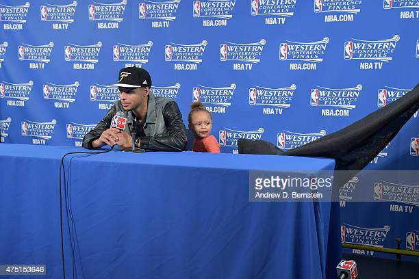 Stephen Curry of the Golden State Warriors speaks to the media with daughter with Riley Curry after a game against the Houston Rockets in Game Five...