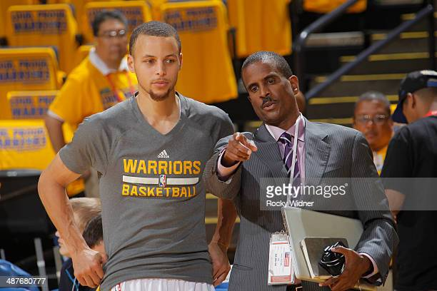 Stephen Curry of the Golden State Warriors speaks with commentator David Aldridge before facing the Los Angeles Clippers in Game Six of the Western...
