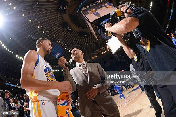 Stephen Curry of the Golden State Warriors speaks with ESPN reporter JA Adande after defeating the Chicago Bulls on November 20 2015 at Oracle Arena...