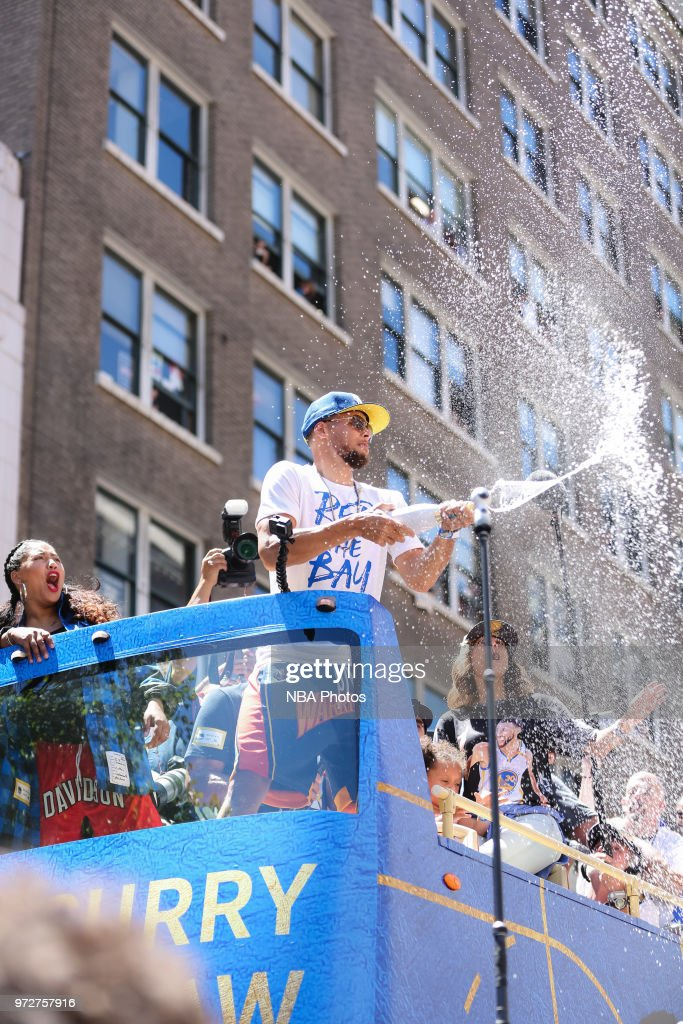 Stephen Curry #30 of the Golden State Warriors sprays champagne into the crowd during the Golden State Warriors Victory Parade on June 12, 2018 in Oakland, California. The Golden State Warriors beat the Cleveland Cavaliers 4-0 to win the 2018 NBA Finals.