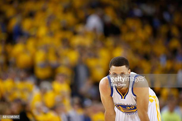 Stephen Curry of the Golden State Warriors stands on the court during their game against the Portland Trail Blazers during Game Five of the Western...