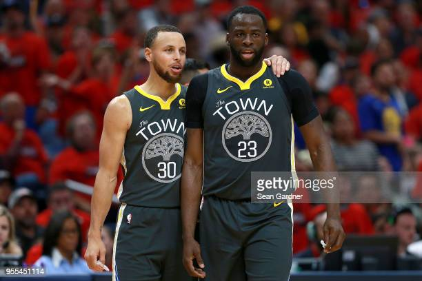 Stephen Curry of the Golden State Warriors stands on the court with Draymond Green of the Golden State Warriors during the first half of Game Four of...