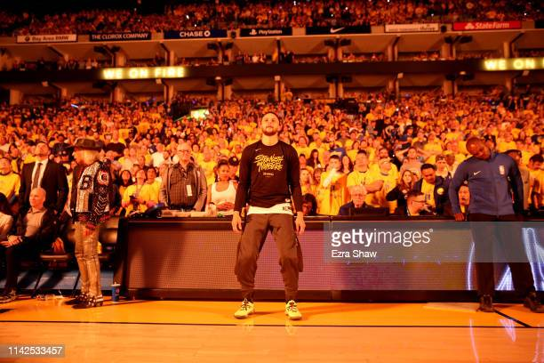 Stephen Curry of the Golden State Warriors stands on the side of the court during player introductions before their game against the LA Clippers...