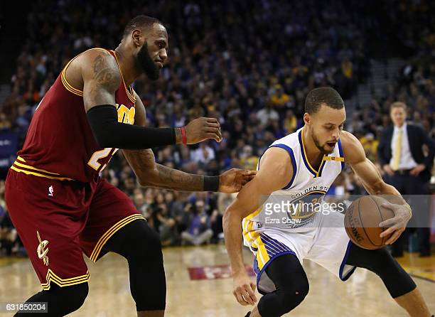 Stephen Curry of the Golden State Warriors steals the ball from LeBron James of the Cleveland Cavaliers at ORACLE Arena on January 16 2017 in Oakland...