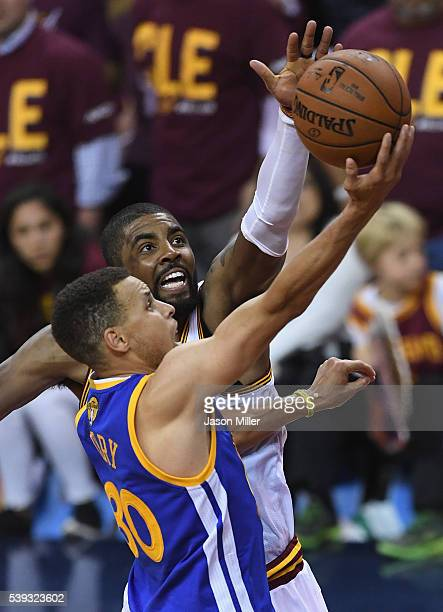 Stephen Curry of the Golden State Warriors takes a shot against Kyrie Irving of the Cleveland Cavaliers in Game 4 of the 2016 NBA Finals at Quicken...
