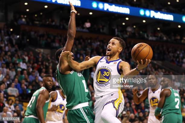 Stephen Curry of the Golden State Warriors takes a shot against Kyrie Irving of the Boston Celtics during the first quarter at TD Garden on November...