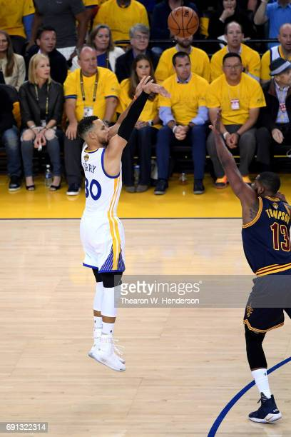 Stephen Curry of the Golden State Warriors takes a shot against Tristan Thompson of the Cleveland Cavaliers in Game 1 of the 2017 NBA Finals at...